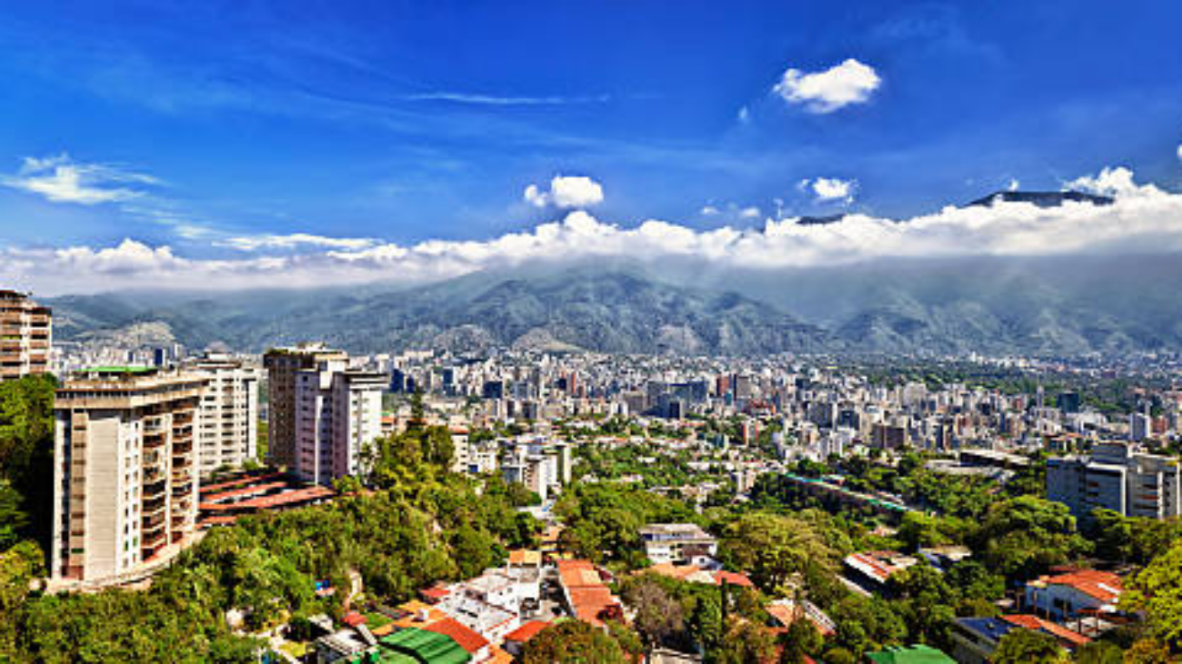 Panoramic image of eastern Caracas city aerial view at late afternoon. Venezuela.  Showing El Avila mountain.